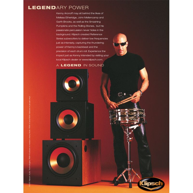 Legendary drummer Kenny Aronoff poses next to a set of Reference Series subwoofers in a Klipsch advertisement. For more information on the Reference Series, go to http://www.klipsch.com/reference