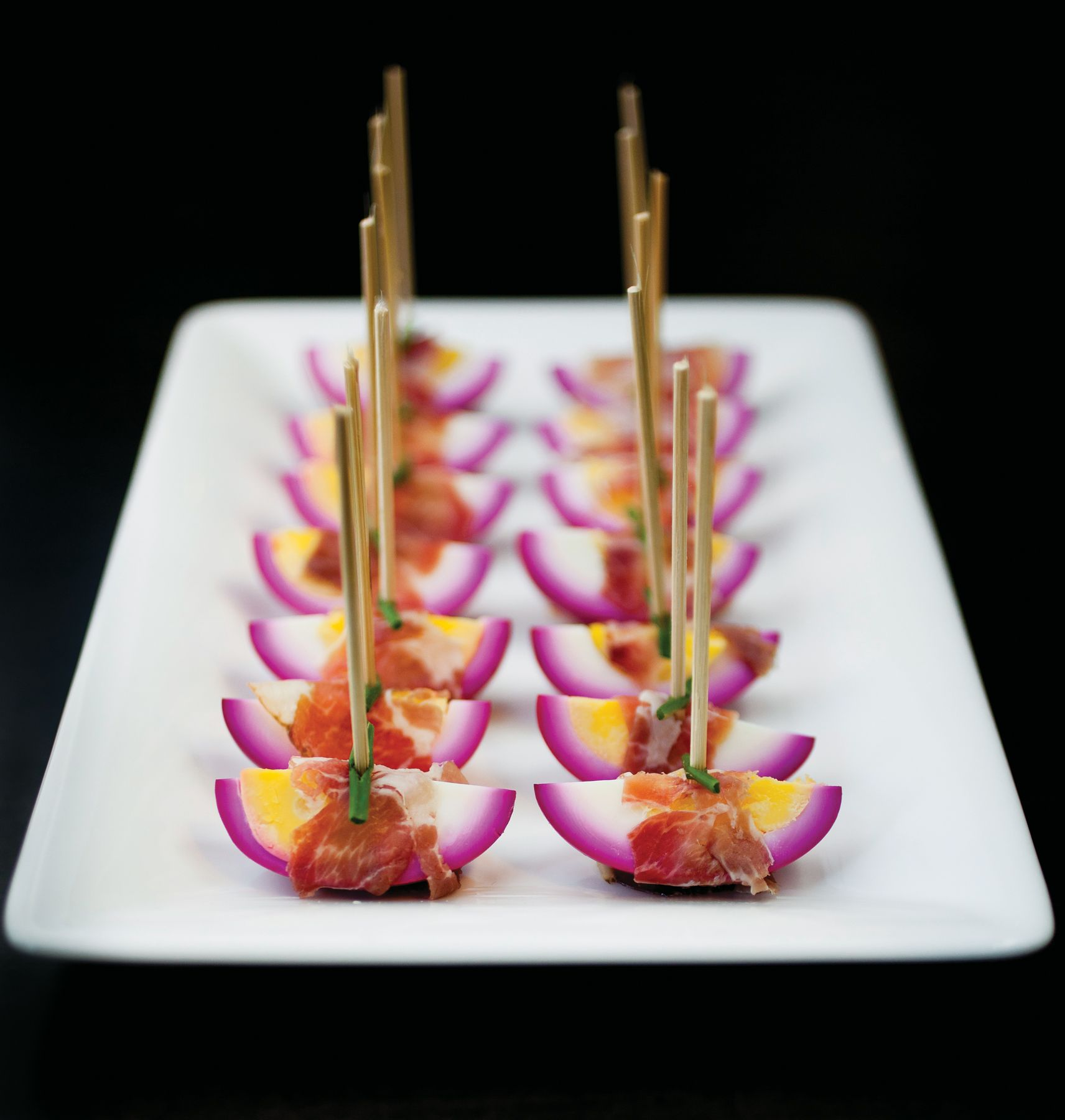 Glitz and gourmet beet pickled eggs wrapped in speck for Canape hors d oeuvres difference