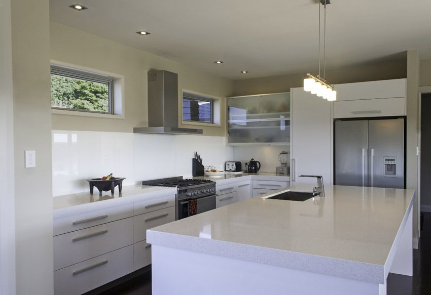 White Modern Kitchen With Stainless Appliances