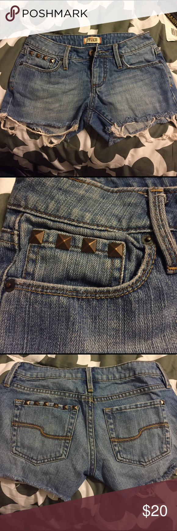"Distressed Tilt cutoff jean shorts. Tilt brand (old PacSun denim brand) size 0 but runs small. Closer to a tight fitting 00. Cutoff jeans shorts with spike embellishment over pockets. 2"" inseam. Only wore them a handful of times. No visible wear other than the furthest left spike on back pocket is missing (pictured). Medium wash. Clean from a pet/smoke free home. PacSun Jeans"
