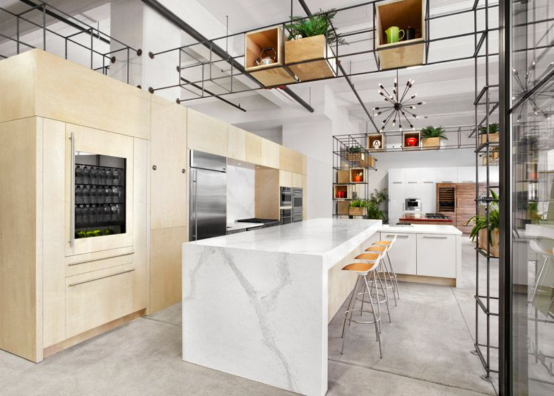 Steel rebar forms storage system at Toronto kitchen showroom by ...