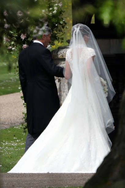 Bride Pippa Middleton and her father Michael Middleton seen arriving at St Mark's Church for her Wedding to James Matthews on May 20 2017 in...
