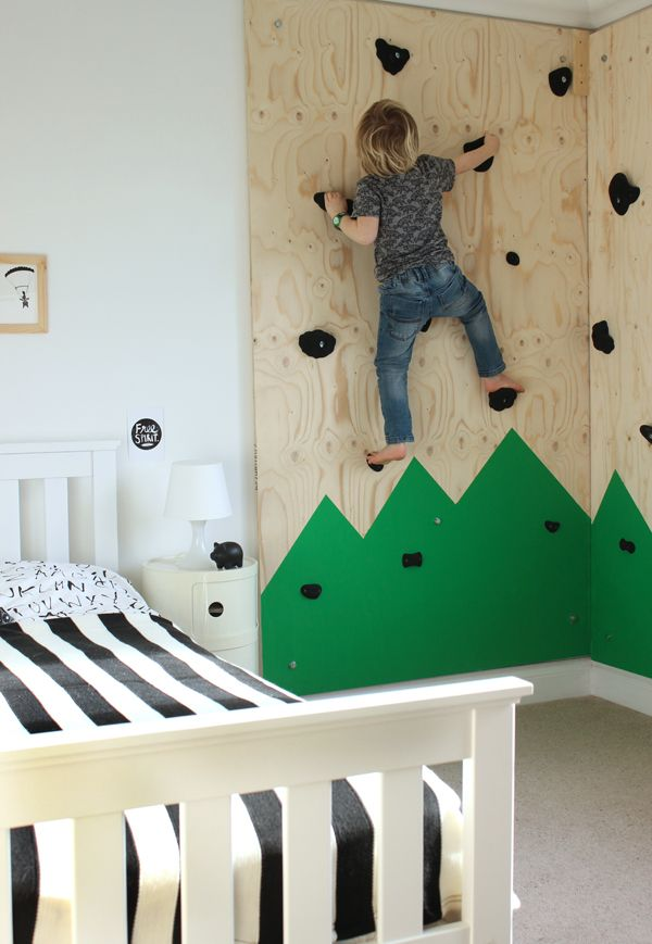 DIY climbing wall for an outdoors themed bedroom
