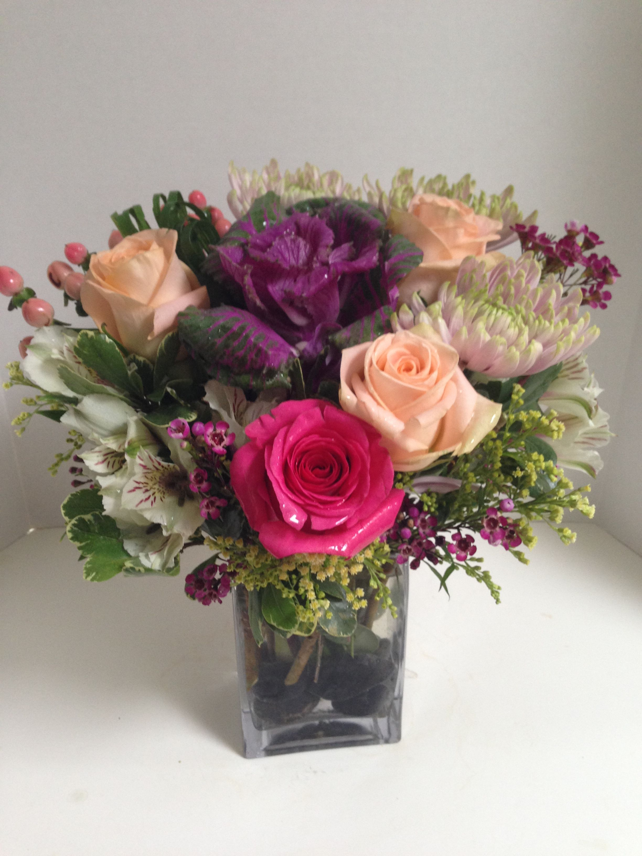 Spring thank you flowers purple ornamental kale is the star spring thank you flowers purple ornamental kale is the star surrounded by tiffany peach roses soft pinkgreen chrysantheumum izmirmasajfo