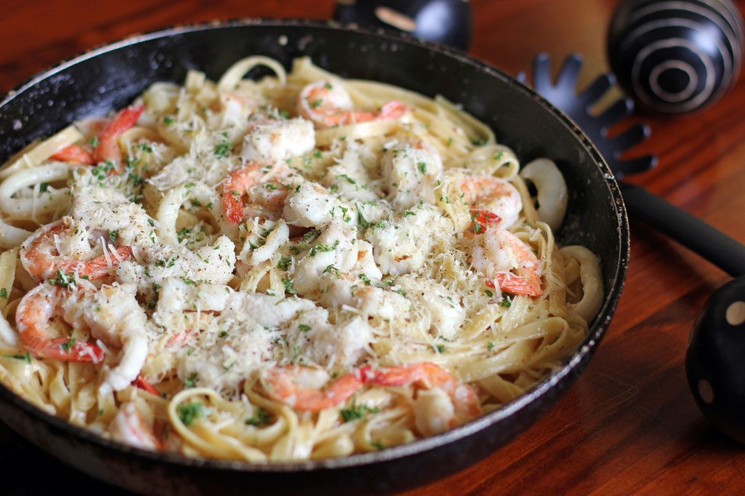 Creamy Seafood Alfredo is a pasta dish made out of mixed seafood like shrimp, squid and fish cooked in cream served with generous amounts of Parmesan cheese.