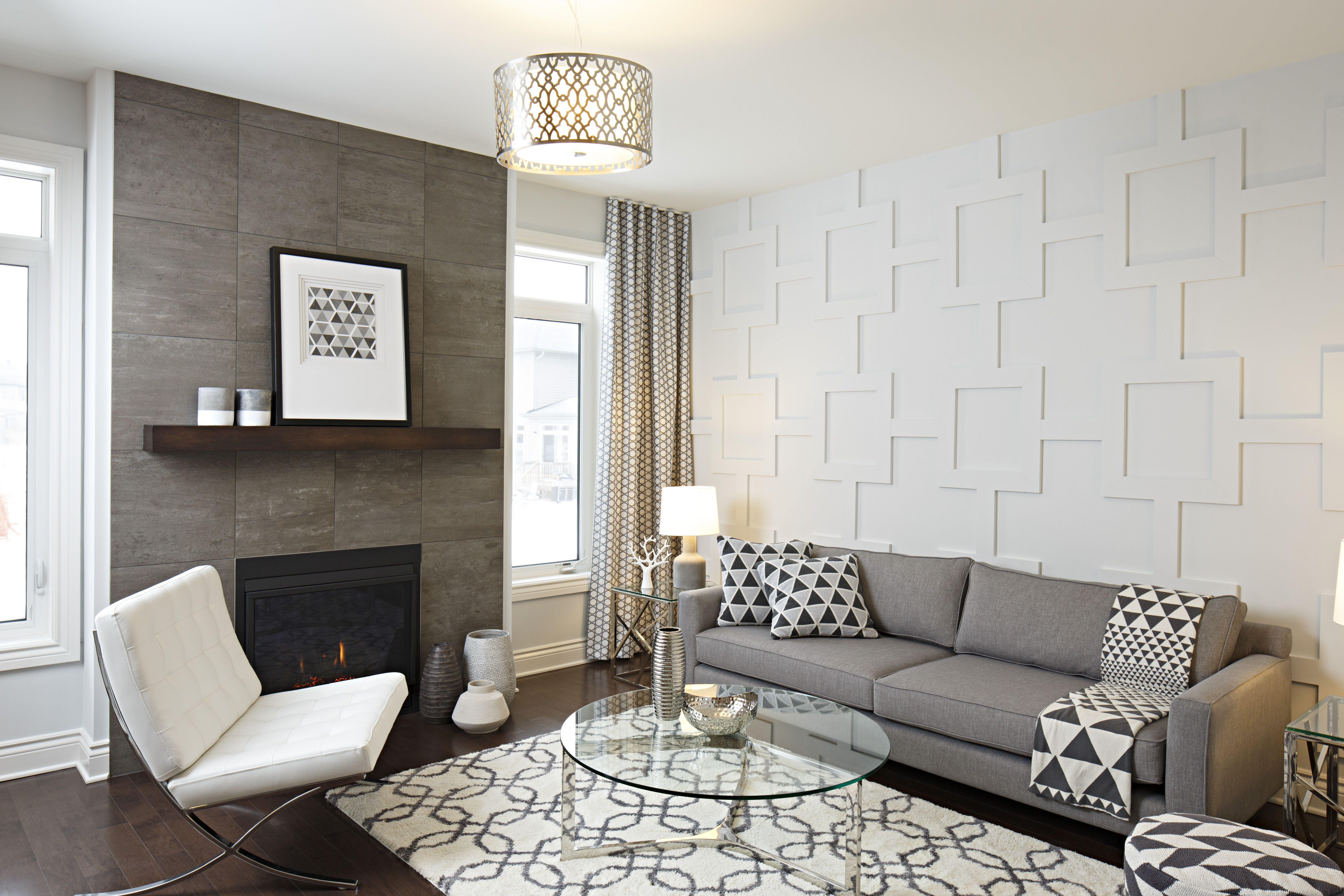 Cozy and trendy living room design featuring tiled fireplace ...
