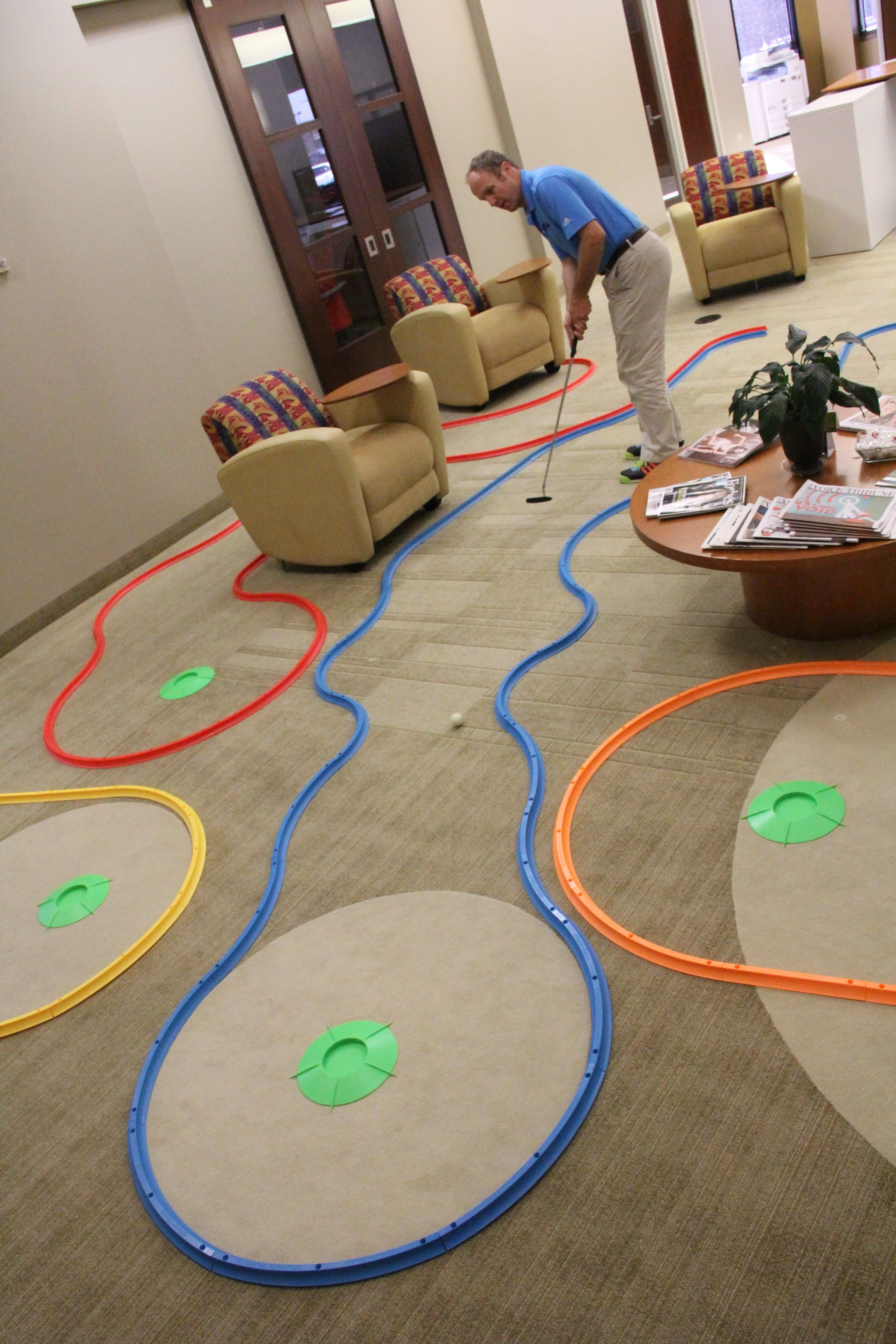 This Is A Sweet Office Golf Set Up I Can T Wait To See It At Night Under The Blacklights Glowgear Net Indoor Mini Golf Golf Birthday Party Office Golf