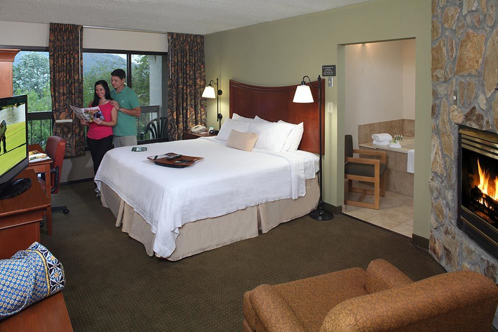King Bed Guest Room with In Room Fireplace and Jacuzzi at Inn on ...