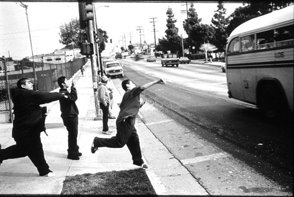 Eastern Los Angeles Gang Life Members Of Evergreen Throw Bottles At A Passing School Bus As A Rival Gang Throws Ha East Los Angeles Chicano Movies Chicano Love