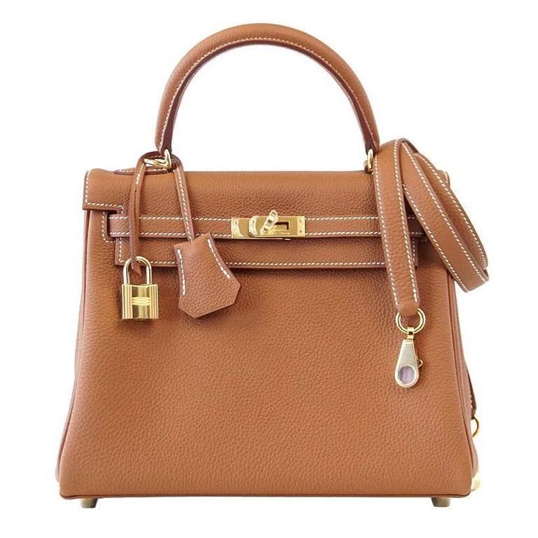 Hermès Top Handle Bag Kelly 25 Retourne Bag Coveted Gold