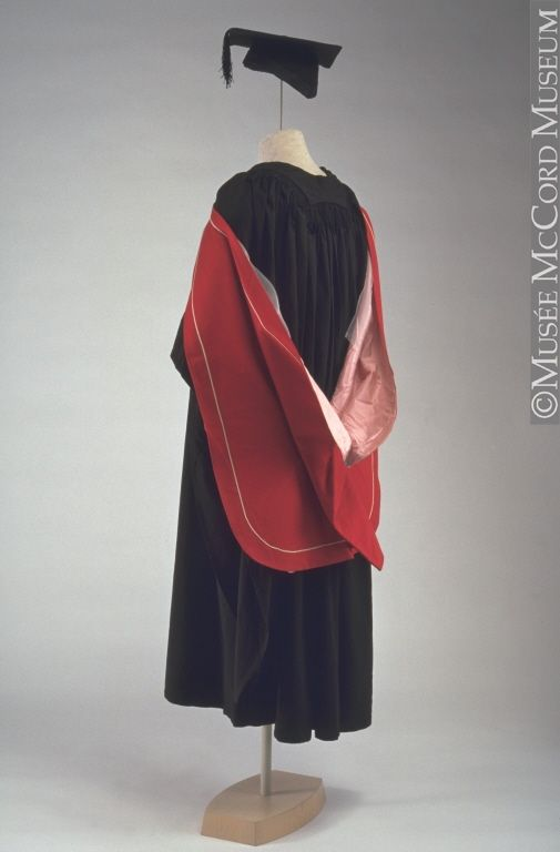 Academic gown, mortarboard and hood. This academic dress was worn by ...