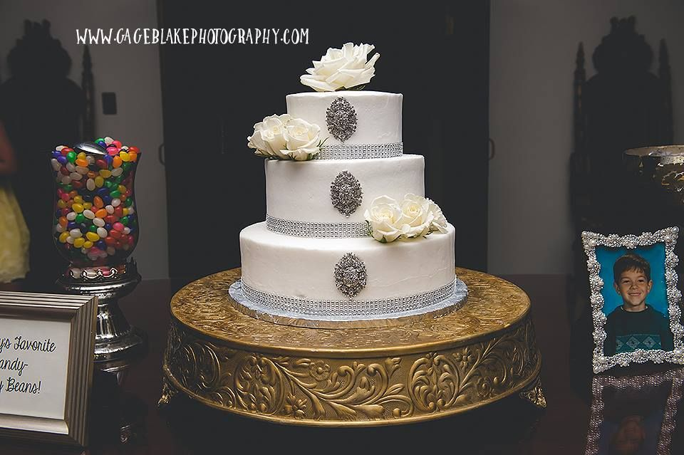 Picture was captured by Gage Blake Photography.Cake table decor created by La Boutique Nostalgie.