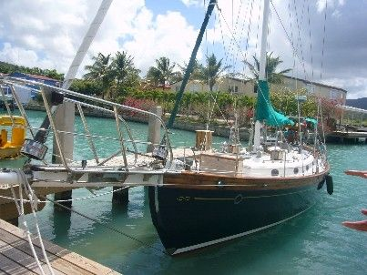 Sydney wishes this were JD's boat. (And I wish it were mine--can't go wrong with Hans Christian!)