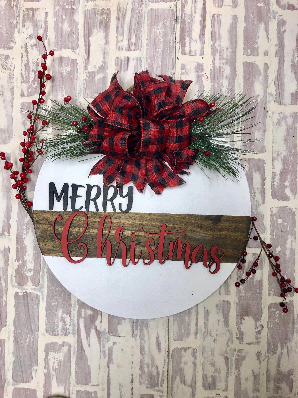 Christmas Door Hanger. The perfect addition to your Holiday Decor!   #homedecor #Christmasdecor #woodmandecorandmore #christmasdoordecorations