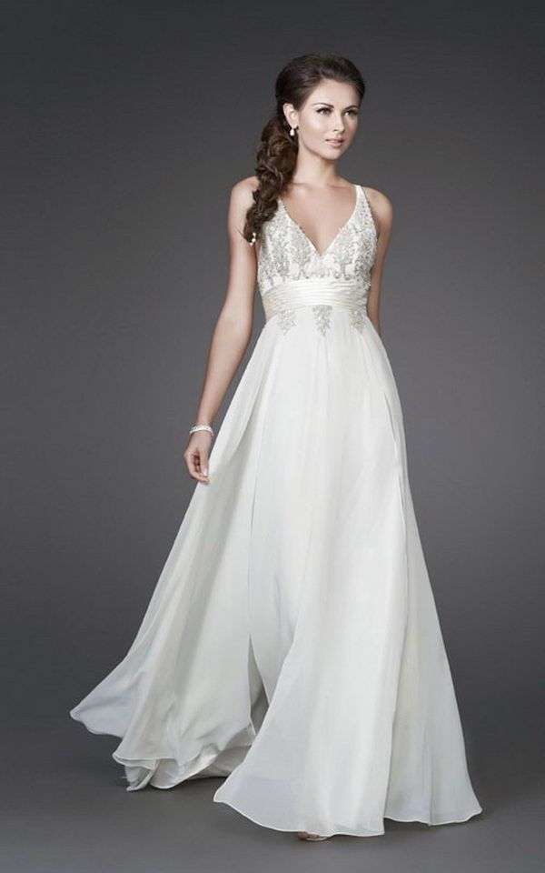 A line v neckline and bust which features floral beading for Flowy wedding dress with sleeves