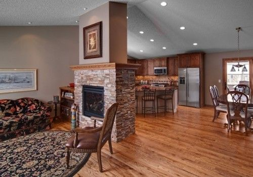 Dual Sided Fireplace Separating Kitchen From Living Room
