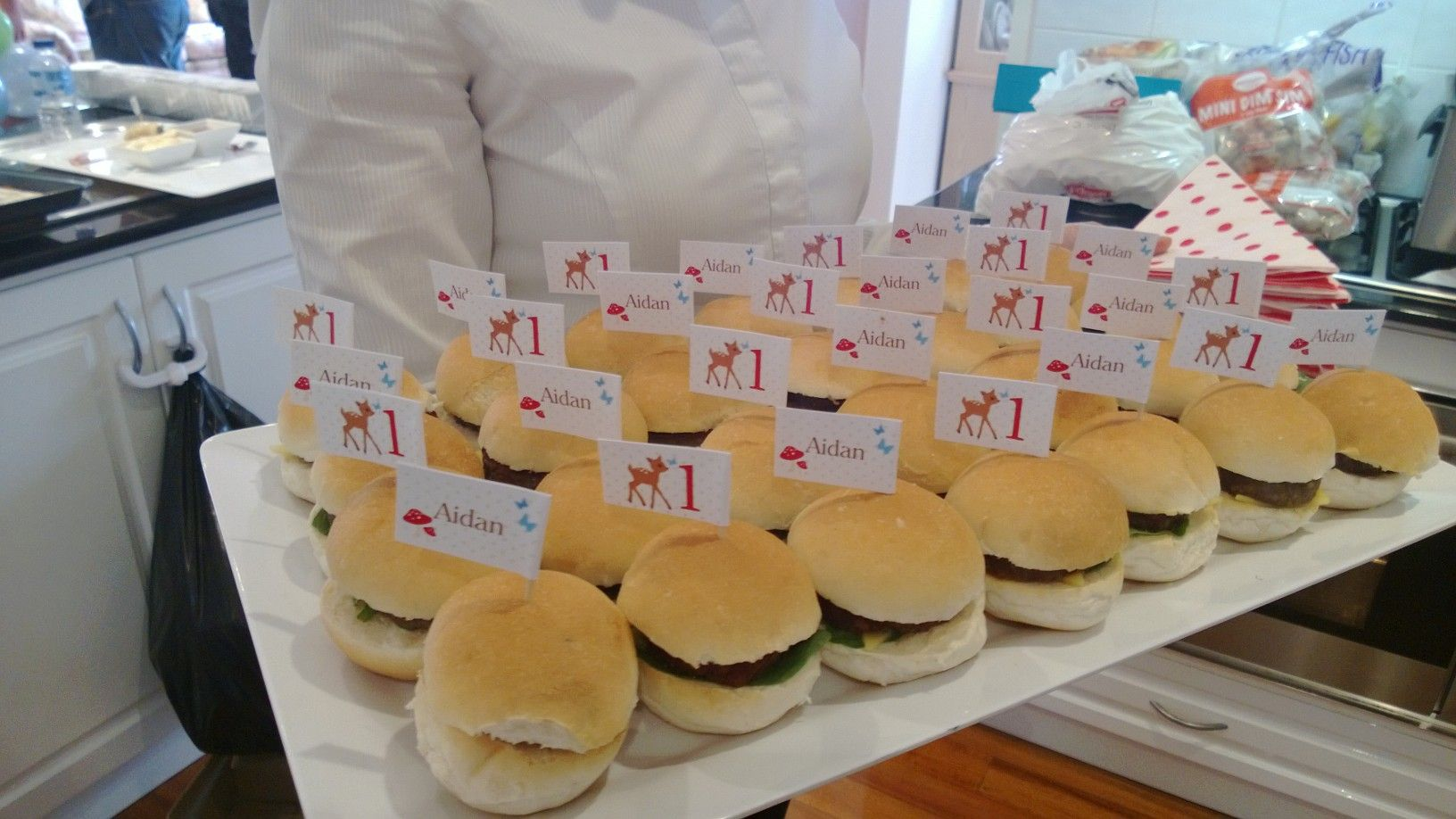 Fresh made little burgers. This set were served up at a 1st birthday party, dressed with hand crafted little toothpick flags