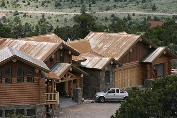 Rustic Metal Roof Log Cabin With Rock Siding Accents Metal Roof Copper Roof Log Home Designs
