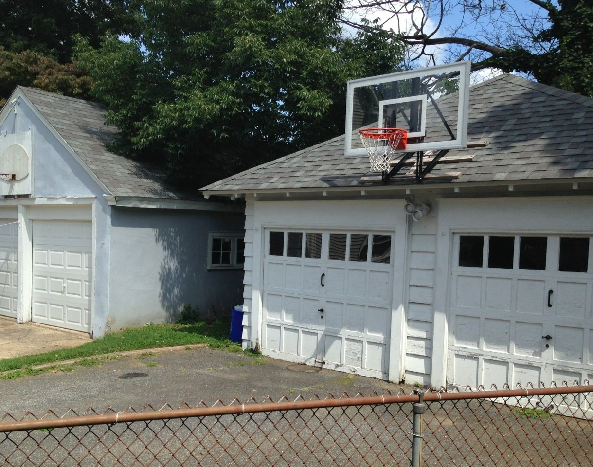 Elegant This Picture Demonstrates A Good Contrast Between A Roof And Wall Mounted  Basketball Goal. You