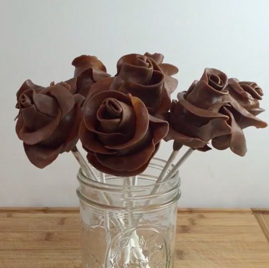 Chocolate roses made with Tootsie Rolls and strawberries. Delicious!
