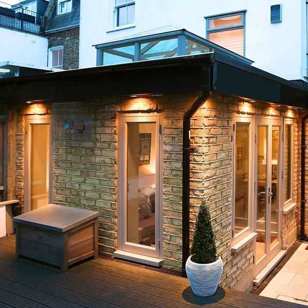 This stunning extension in SW11 uses roof lanterns and broken space planning to maximum effect creating an eclectic feel. The rear section has been redesigned to accommodate as much light ... Read More #extensionideas