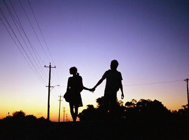 Teenage Couple Holding Hands
