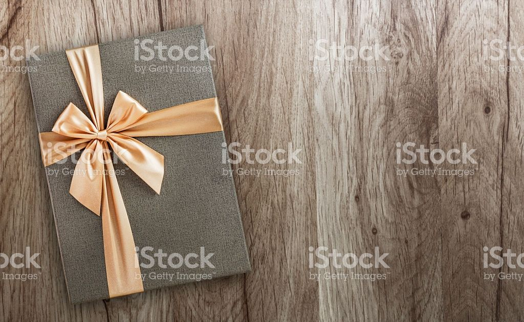 Gift box on wood, top view Royalty-free stock photo