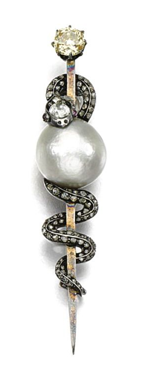 Pearl and Diamond Brooch, c1860. A coiled snake holding a button-shaped pearl, the head inset with a cushion-shaped diamond, ruby eyes, the body highlighted with diamonds. (Sotheby's)