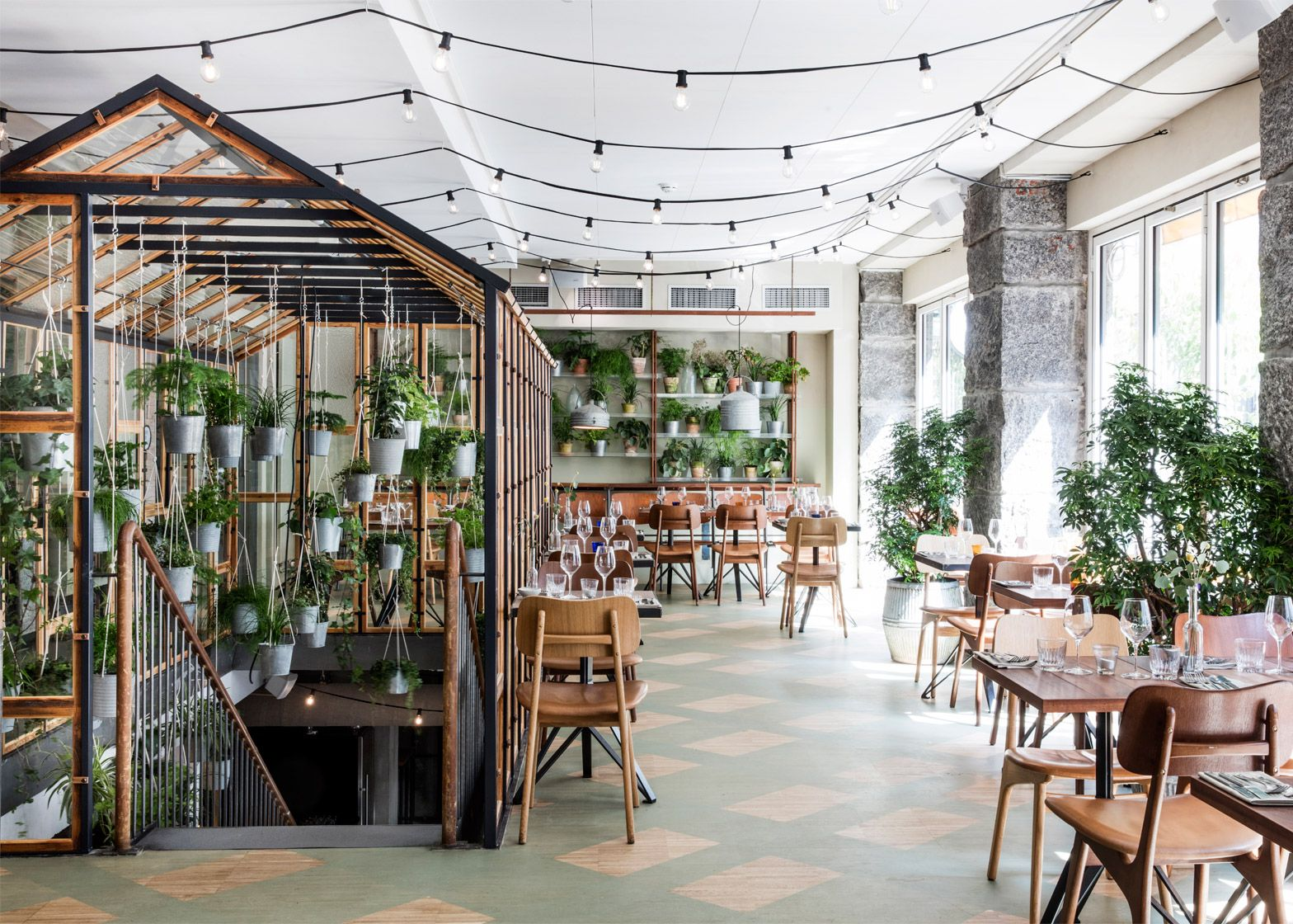 genbyg's indoor garden restaurant made of recycled materials
