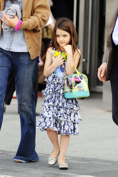 Suri Cruise (too cute.) -- Ruffles? Check. Florals? Check. Neon? Check. All the makings of a future fashionista in the works? Check. This photo says it all. Katie's mini-me is gonna be just like mommy when she's all grown up.