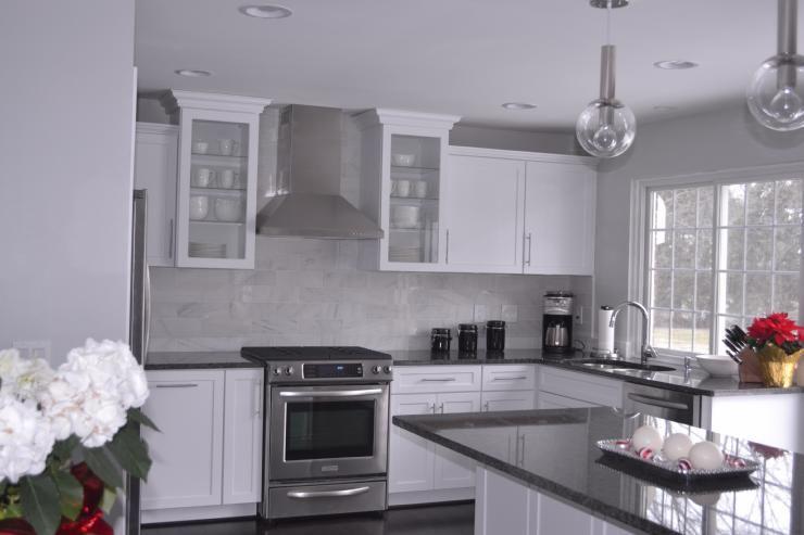 Steel gray granite countertops carrara marble backsplash for White kitchen cabinets with grey granite countertops