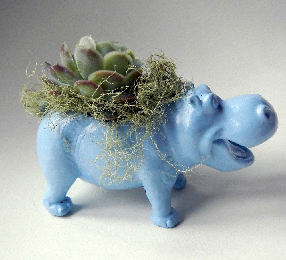 Small hippopotamus brooch with blue and black ceramic floral decoration modeled and decorated by hand