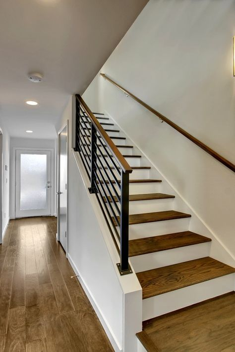 Contemporary Staircase With Wall Sconce, Hardwood Floors, High Ceiling