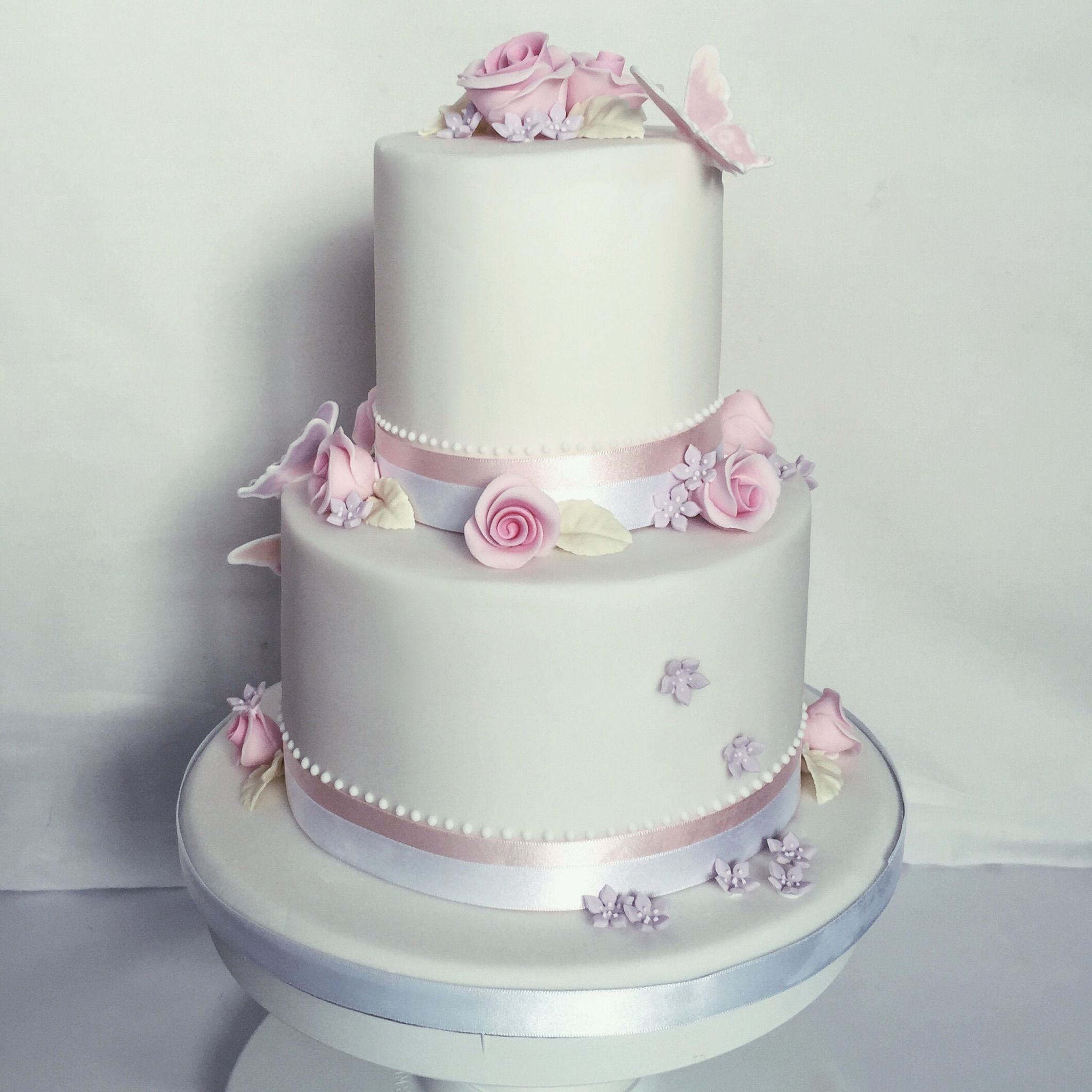 Decorated Cake with Roses and Butterflies made by Rose Brittney