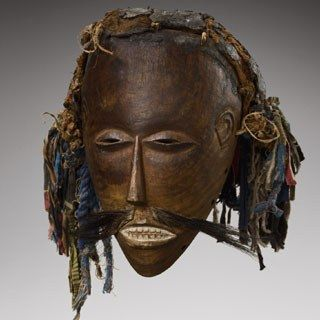 This mask of the Luvale of Zambia is a caricature of a white man who can be recognised by his pointy nose and stiff moustache. Many peoples of Sub-Saharan Africa have used, and sometimes still use, masks for ritual, political or festive purposes – the one not necessarily excluding the other.  The mask must be considered as a whole which includes the object – the mask itself – but
