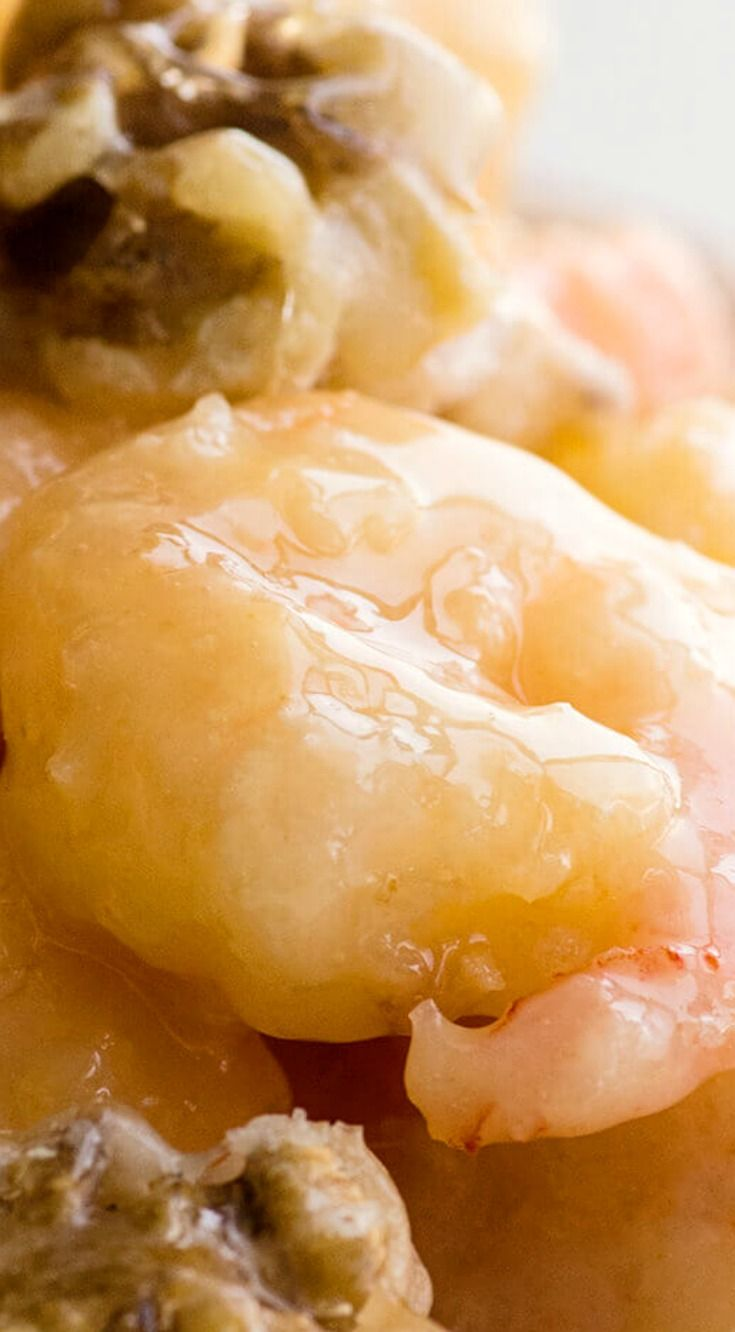 Honey Walnut Shrimp ~ Breaded and fried shrimp with a sweet creamy sauce and topped with candied walnuts… YUM!
