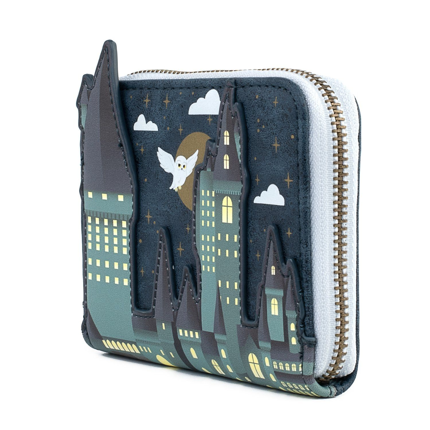 """Hogwarts was a large, seven-storey building supported by magic, and was often regarded as the finest wizarding school in the world. Acting as the primary location for the Harry Potter stories, it was filled with magical wonder and awe, full of secrets to discover and adventures to be had. Constructed from faux leather, this 5"""" Zip-Around Wallet features the magical wizarding school in a custom-shaped design, with the building popping out from the wallet thanks to the embroidrered and applique de"""