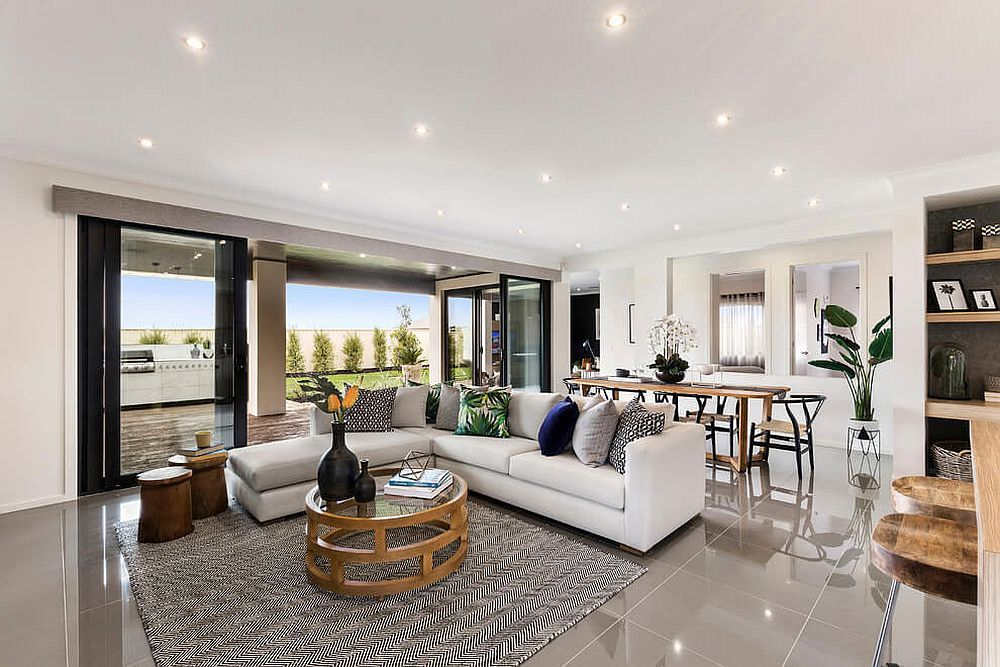 Living room with lovely ambient lighting sparkling floor and a sectional in white
