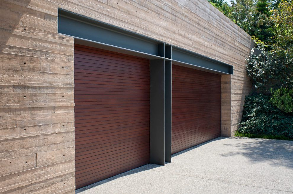 Bifold garage door hardware can look confusing but they work on a simple principle. Two hinges at the ends of each garage door are connected together ... & Bifold garage door hardware can look confusing but they work on a ...