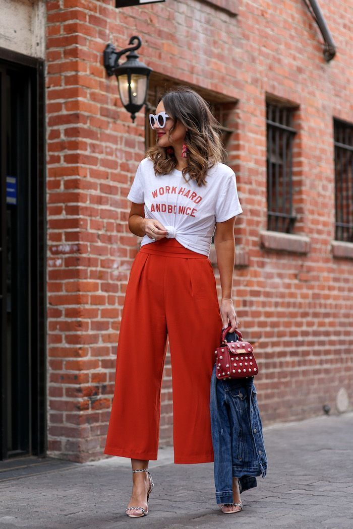 65cf3485f088 red jumpsuit paired with graphic tee