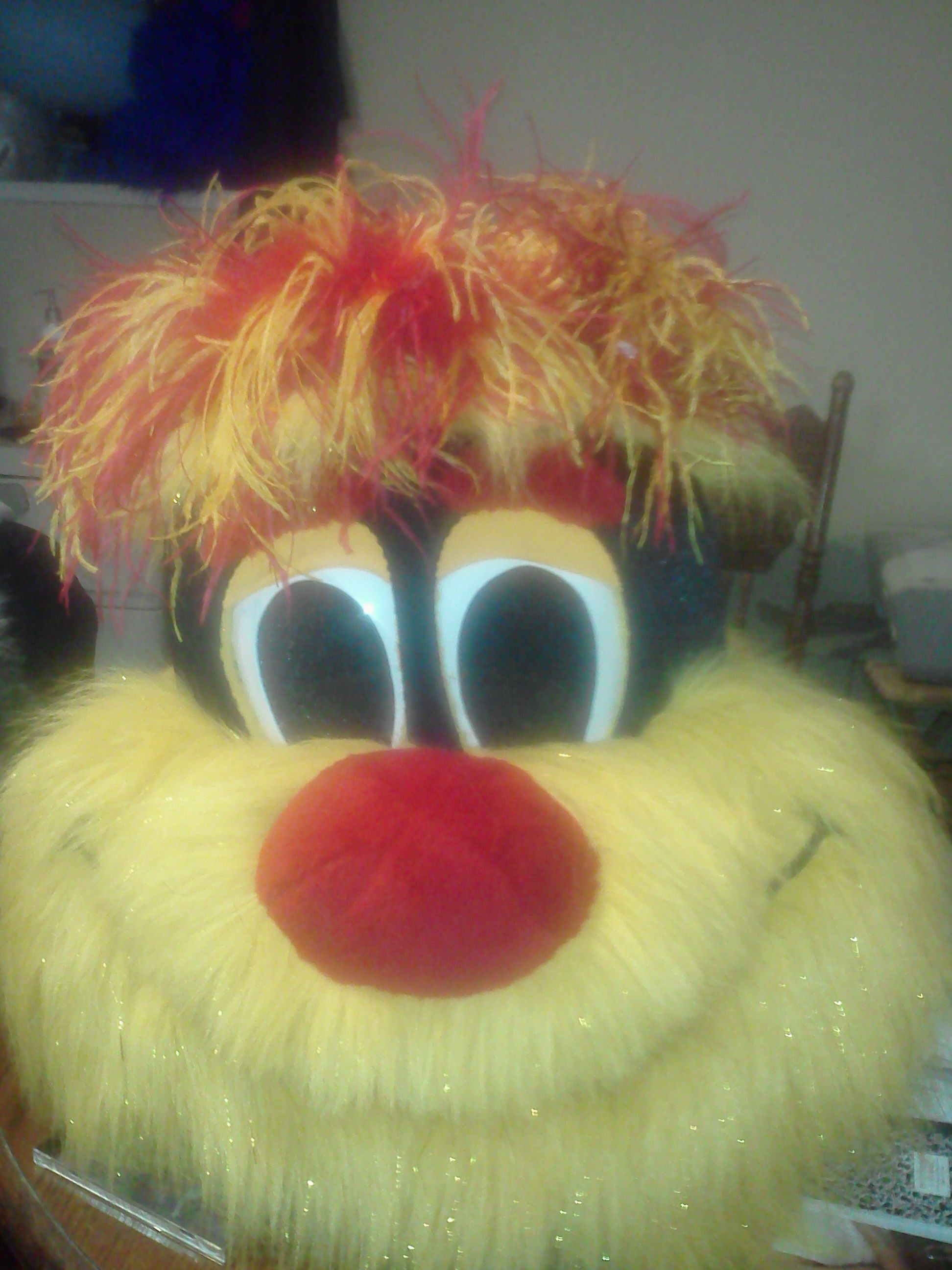 Custom mascot costume with ostrich feather hair