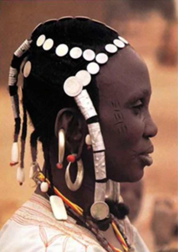 Africa | Hair jewellery of coins and white shell beads worn by a Fulani woman from the Upper Volta | ©Angela Fisher, Africa Adorned.  London: Collins, 1984 //
