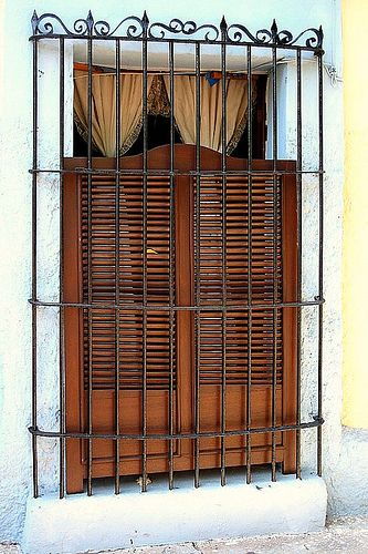 Whoa! this is what i want for my dream house. Shuttered Window with iron bars