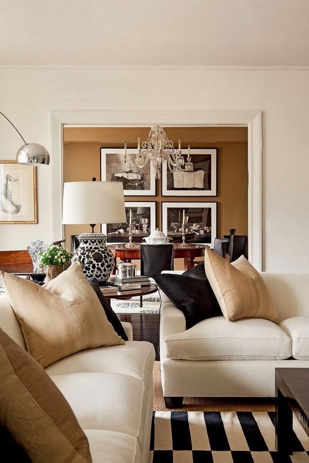 This color mix is warm and inviting. The caramel color on the wall in the dining room is repeated in pillows and other decorative accessories.