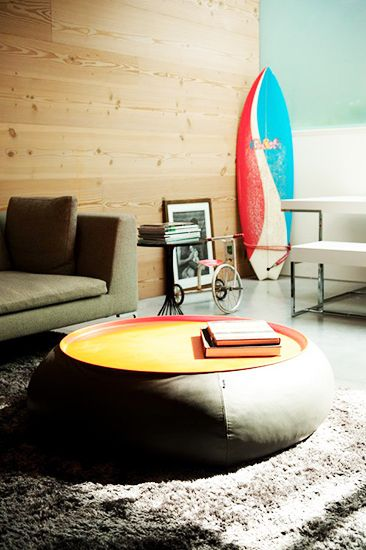 21 Homes That Prove Surf Is Chic // surfboards as decor // beanbag coffee table, wood wall, white modern picnic table