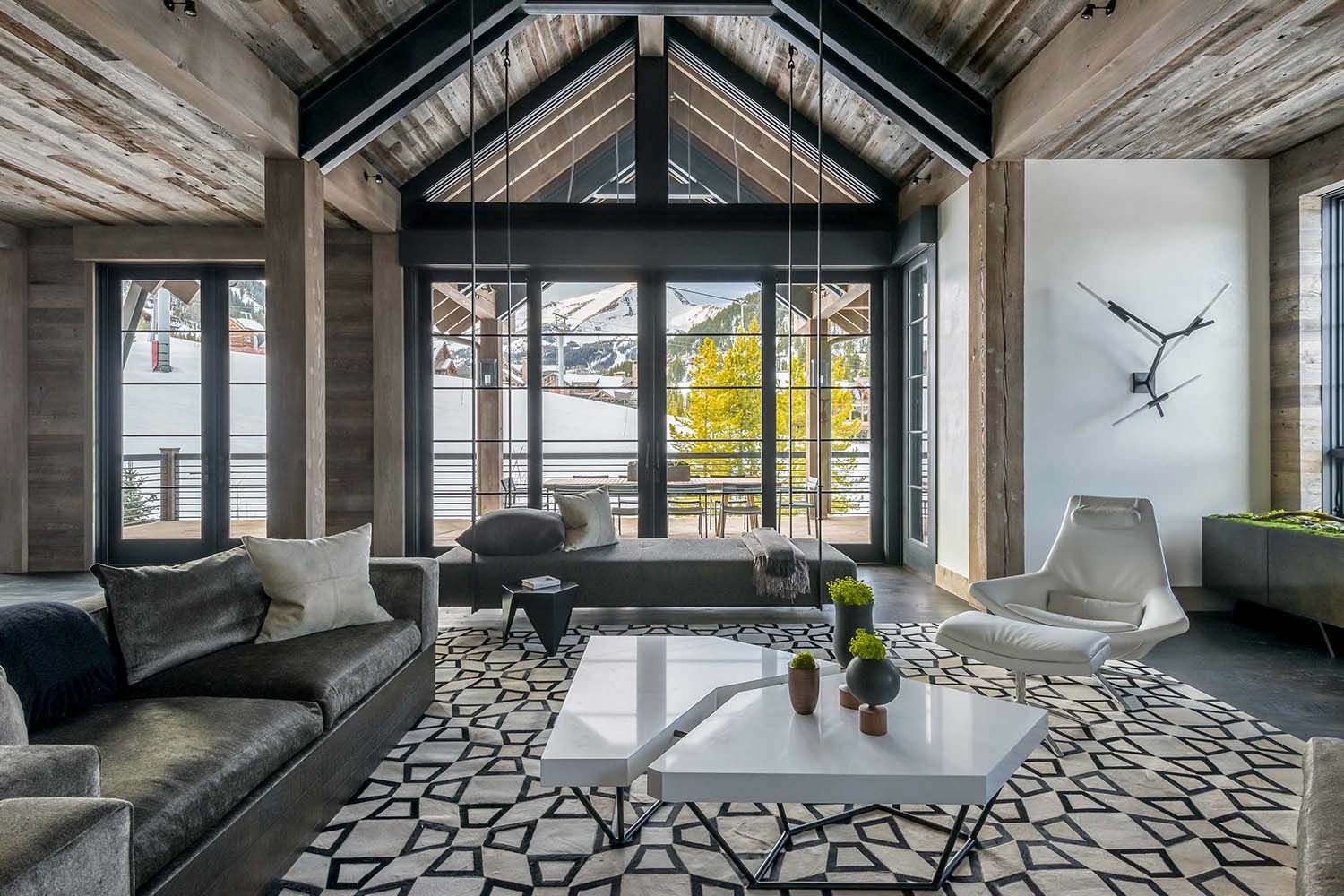 The hillside snowcrest residence is a rustic modern ski in ski out luxury chalet designed by locati architects located in the yellowstone club montana