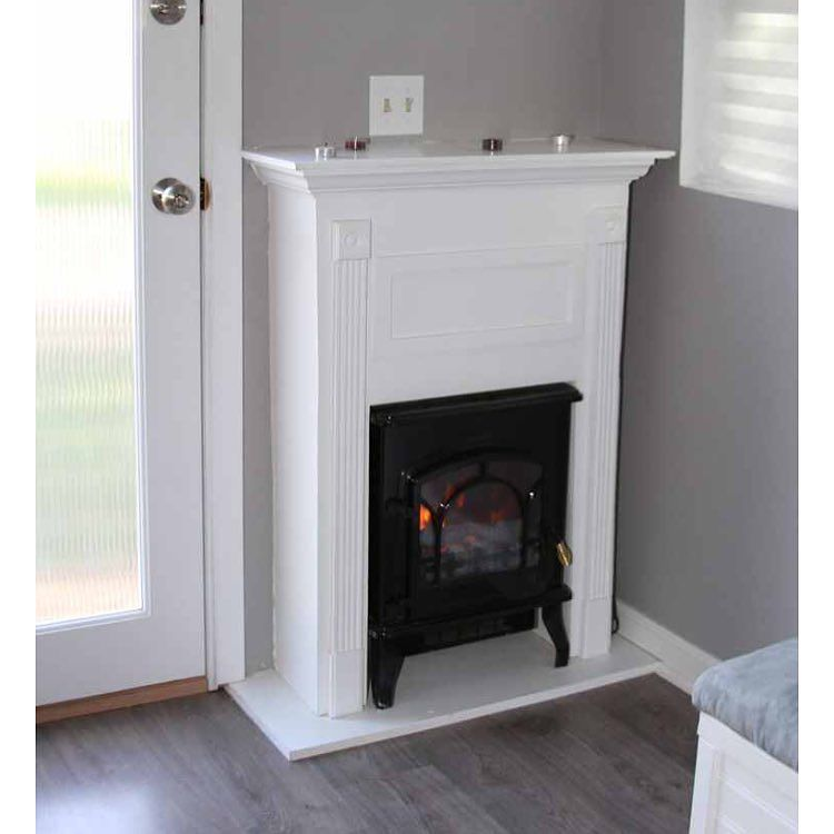 i love the idea of a small mantle built around the wood burning stove gives it the big home. Black Bedroom Furniture Sets. Home Design Ideas