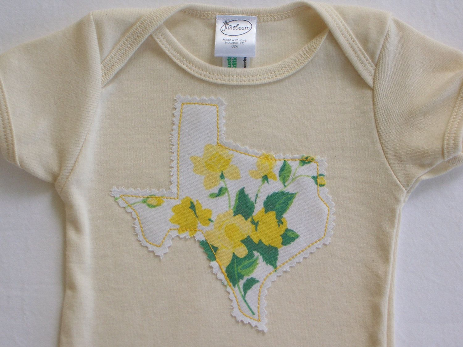 Texas onesie organic cotton with vintage applique in yellow rose