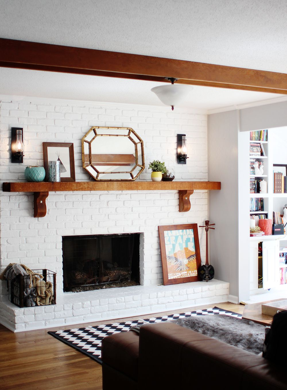 Wood mantle and white brick fireplace living room ideas