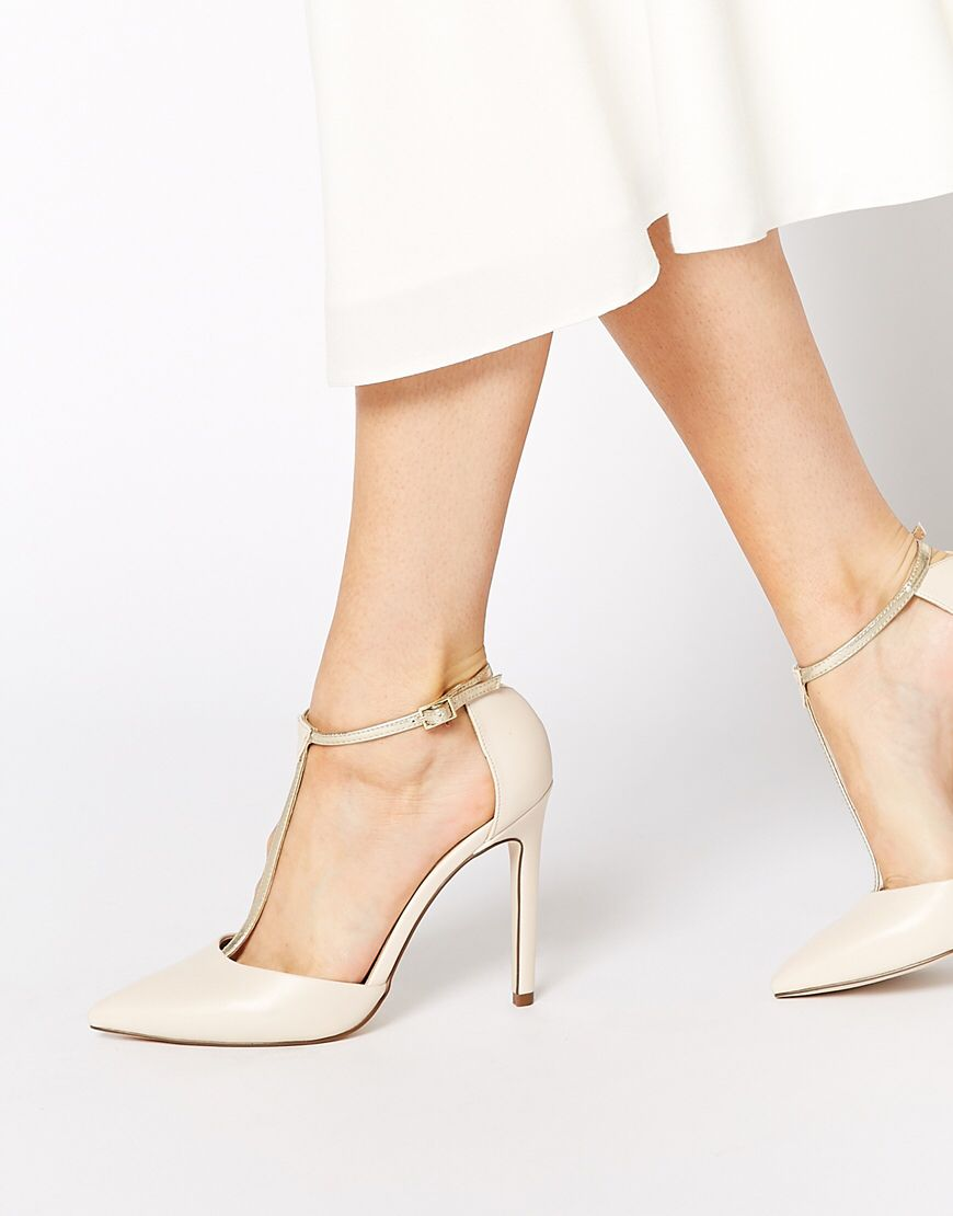 Heels by ASOS Collection Smooth leatherlook upper Pin buckle ankle strap Pointed  toe High point heel Wipe with a soft cloth Polyurethane Upper Heel Height: